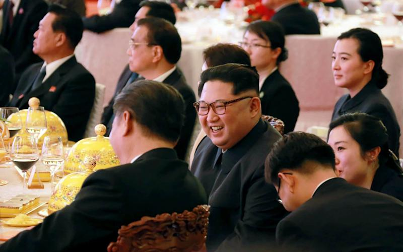Kim Jong-un during a dinner banquet at the Great Hall of the People in Beijing, March 26 - AFP