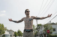 """In this image released by Universal Pictures, Pete Davidson appears in a scene from """"The King of Staten Island,"""" directed by Judd Apatow. The film will be available for streaming on HBO Max on Saturday. (Mary Cybulski/Universal Pictures via AP)"""