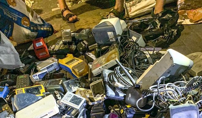 The night market is full of second-hand electronic devices such as radios and feature phones. Photo: SCMP