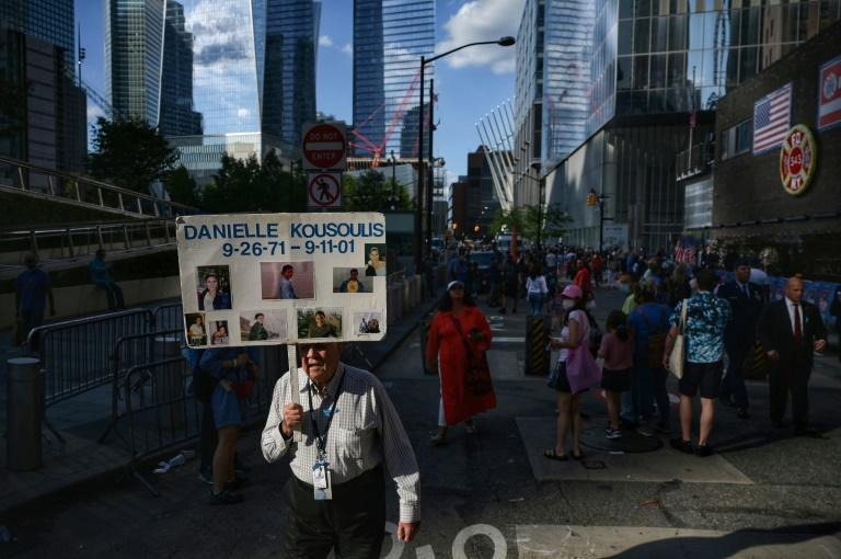 A man walks with the name of a loved one lost in the 9/11 attacks on the World Trade Center outside the 9/11 Museum and Memorial in New York (AFP/Ed JONES)