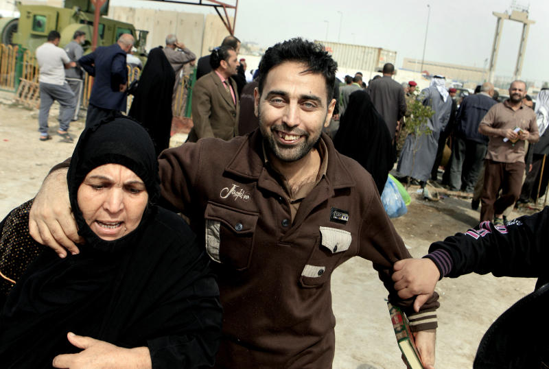 A former prisoner holds his mother, Umm Satar, left, after being released from a prison in Baghdad, Iraq, Thursday, Feb. 28, 2013. Some 165 prisoners were released from the Iraqi Interior Ministry custody on Thursday. (AP Photo/ Karim Kadim)