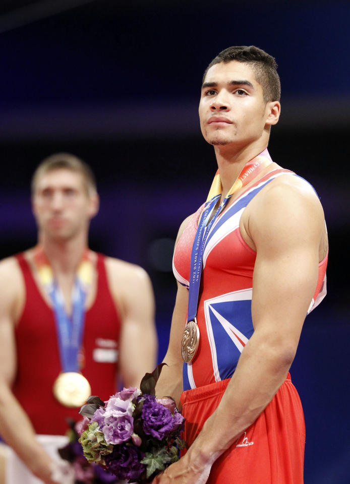 Britain's Louis Smith poses with bronze medal on the podium during the final of the men's pommel horse at the Artistic Gymnastics World Championships in Tokyo, Japan, Saturday, Oct. 15, 2011. (AP Photo/Bullit Marquez)