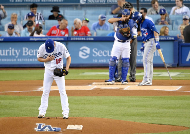 Los Angeles Dodgers starting pitcher Kenta Maeda gets set to pitch during the first inning of the team's baseball game against the Toronto Blue Jays on Thursday, Aug. 22, 2019, in Los Angeles. (AP Photo/Mark J. Terrill)