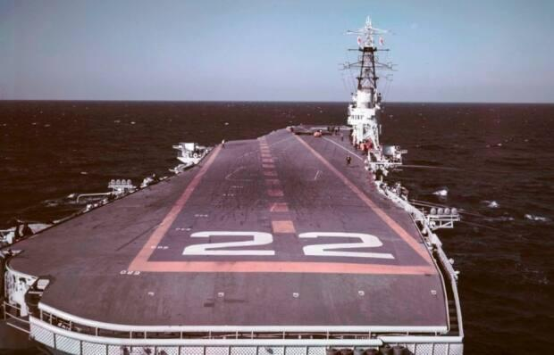 The view of HMCS Bonaventure from the cockpit of an aircraft about to land.