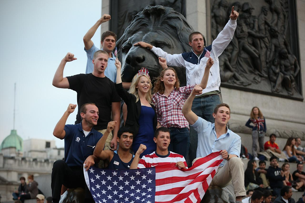 LONDON, ENGLAND - JULY 27:  United States' fans celebrate the openning of the London 2012 Olympic Games at Trafalgar Square on July 27, 2012 in London, England.  (Photo by Feng Li/Getty Images)