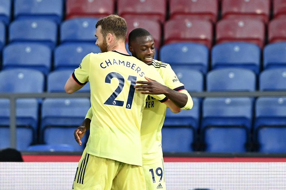 <p>Calum Chambers and Nicolas Pepe are developing a good understanding at Arsenal</p> (Getty Images)