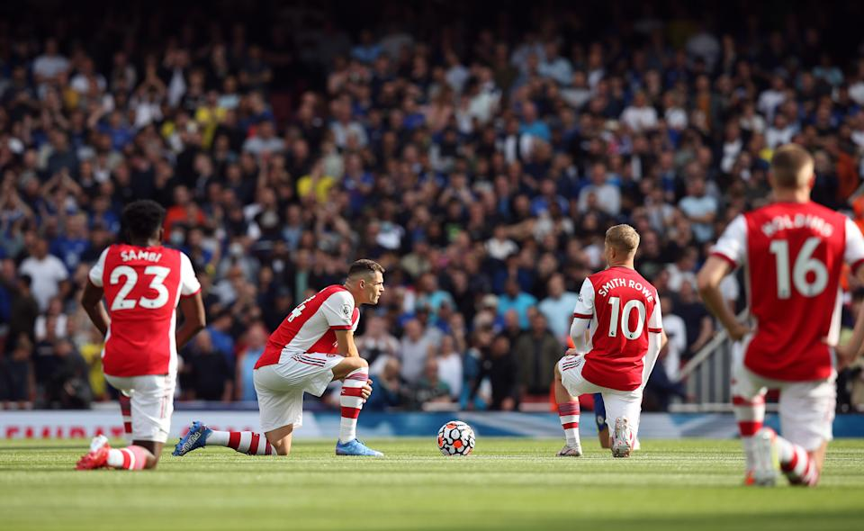 Five years after Kaepernick's first protest, Arsenal players take the knee before their Premier League game against Chelsea on August 22. (Getty)