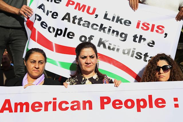 """Kurds from Kirkuk stage a protest in front of the U.S. Consulate in Irbil, the capital of Kurdistan Region, Iraq, Oct. 20, 2017. The protesters hold banners reading """"Kurds are under attack by Shiite Hashd al Shaabi militants using American weapons."""" Iraqi forces and Shiite-led pro-government Hashd al Shaabi militias moved to reclaim control over Kirkuk from the local Kurdish authority following the Sept. 25 independence referendum in Kurdistan. (Photo: Gailan Haji/EPA-EFE/REX/Shutterstock)"""