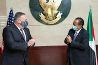 US Secretary of State Mike Pompeo, on a rare visit to Sudan in August 2020, greets Sudanese Prime Minister Abdalla Hamdok amid talks on removing Khartoum as a state sponsor of terrorism