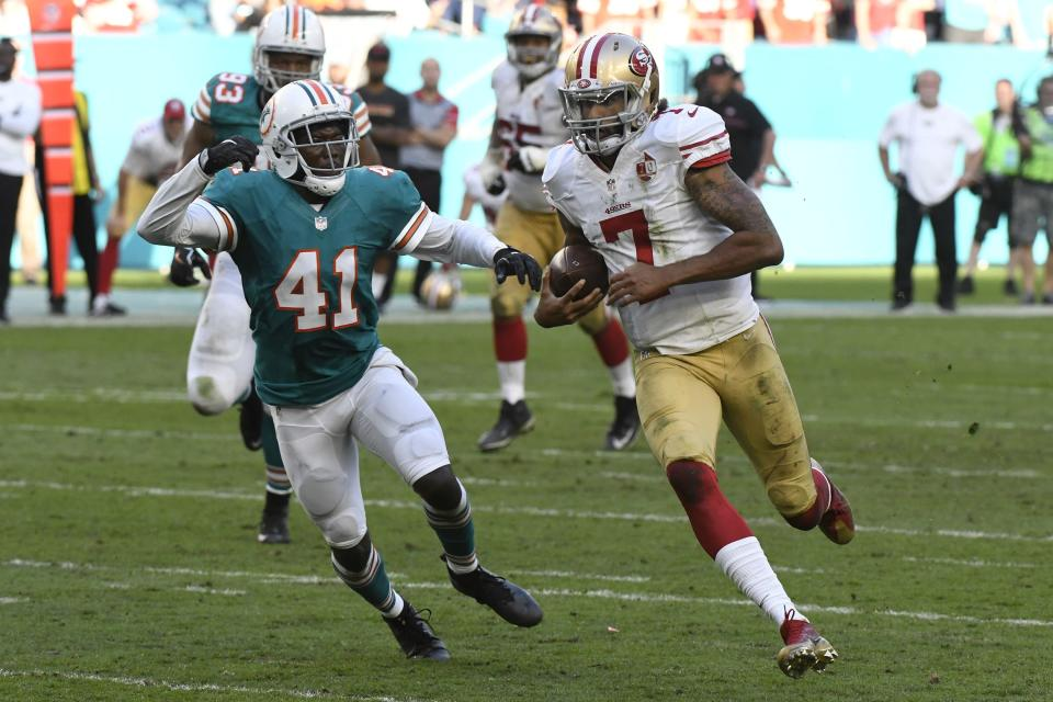 Colin Kaepernick, playing in a 2016 game against the Dolphins, continues to press his grievance against the league, alleging that he's being blackballed. (AP)