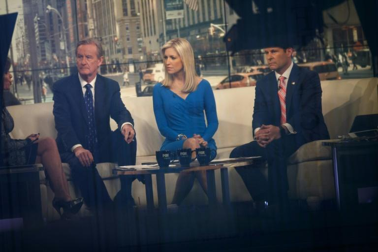 "One of Trump's favorite programs on the network remains ""Fox & Friends,"" whose hosts (L to R) Steve Doocy, Ainsley Earhardt and Brian Kilmeade are seen in a February 17, 2017 broadcast (AFP Photo/Drew Angerer)"