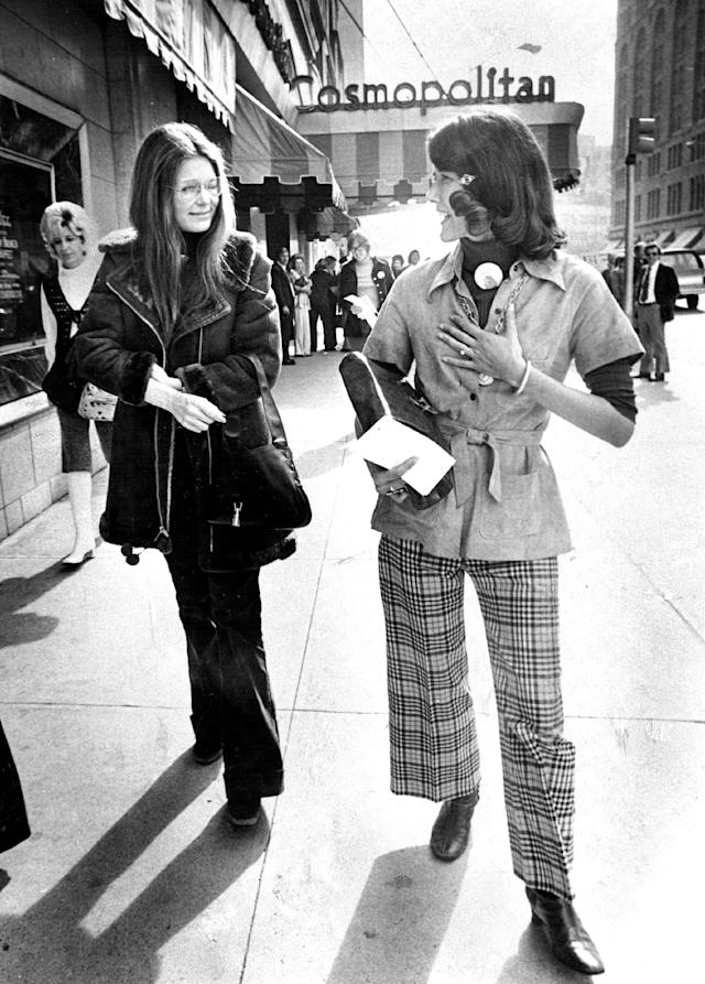Gloria Steinem, left, accompanies then-Rep. Pat Schroeder (D-Colo.) down a Denver street in 1974. (Photo: Getty Images)