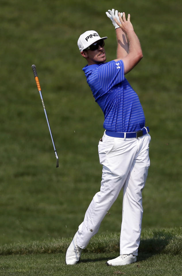 Hunter Mahan loses his club as he hits on the 14th fairway during the second round of the AT&T National golf tournament at Congressional Country Club in Bethesda, Md., Friday, June 29, 2012. (AP Photo/Patrick Semansky)