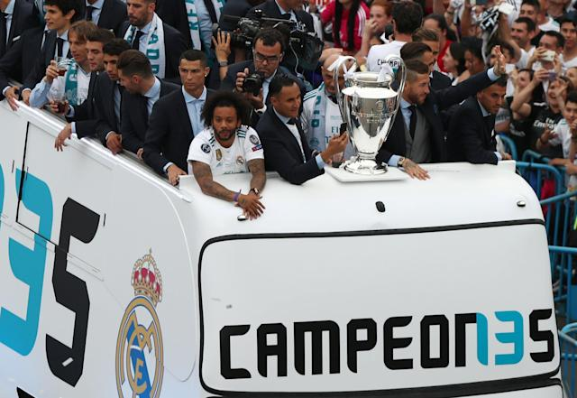 Soccer Football - Real Madrid celebrate winning the Champions League Final - Madrid, Spain - May 27, 2018 Real Madrid's Cristiano Ronaldo and Marcelo during victory celebrations REUTERS/Sergio Perez