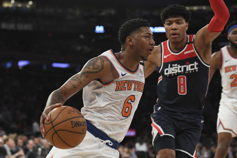 New York Knicks guard Elfrid Payton (6) dribbles the ball as Washington Wizards forward Rui Hachimura (8) defends during the second half of an NBA basketball game, Wednesday, Feb. 12, 2020, in New York. The Wizards won 114-96. (AP Photo/Sarah Stier)