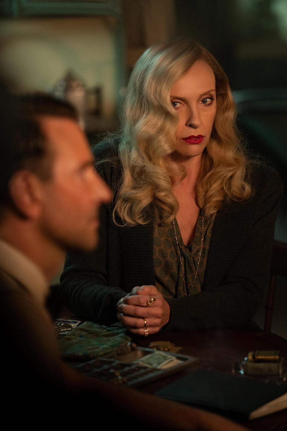 """Bradley Cooper and Toni Collette in """"Nightmare Alley"""" - Credit: Kerry Hayes"""