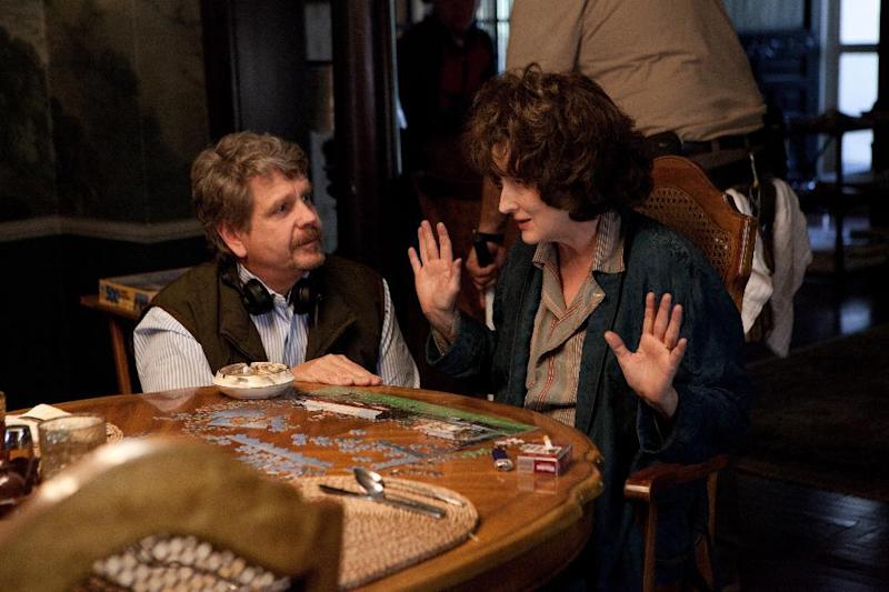 "This image released by The Weinstein Company shows director John Wells, left, and actress Meryl Streep during the filming of ""August: Osage County."" Streep was nominated for a Golden Globe for best actress in a motion picture musical or comedy for her role in the film. (AP Photo/The Weinstein Company, Claire Folger)"