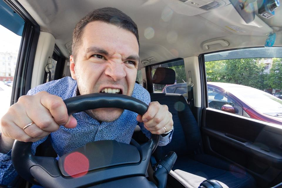 Man Biting a Steering Wheel Commonly Misused Phrases