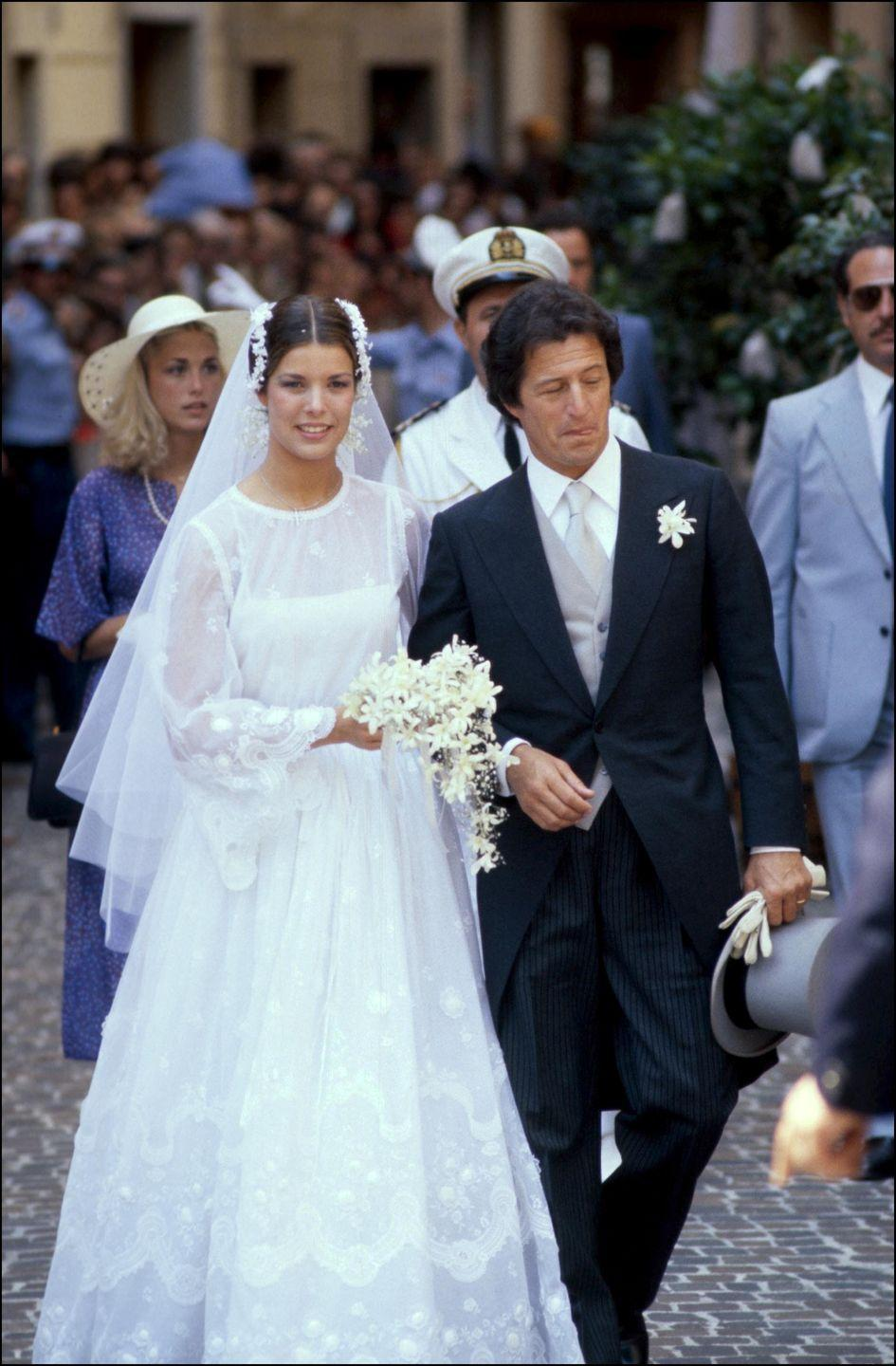 <p>The Princess of Monaco looked ethereal in a lace dress with bell sleeves by Marc Bohan for Dior when she wed Philippe Junot in 1978. </p>