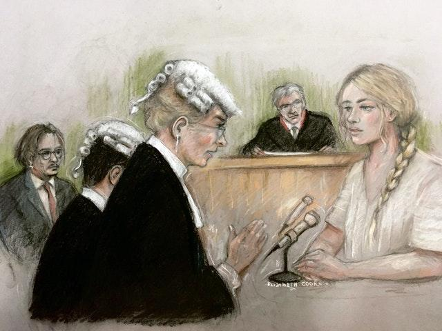 Court artist sketch by Elizabeth Cook of actress Amber Heard being questioned by Sasha Wass QC as she gives evidence at the High Court in London during a hearing in Johnny Depp's libel case against the publishers of The Sun and its executive editor, Dan Wootton