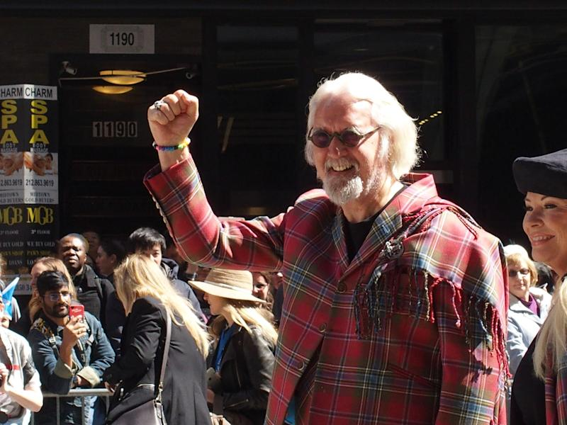 April 6, 2019 - New York, NY - Tartan Day Parade winds it's way up 6th avenue in Manhattan with Sir Billy Connolly as Grand Marshal and his wife by his side Pamela Stephenson. (Photo by Bruce Cotler/Globe Photos/Sipa USA)