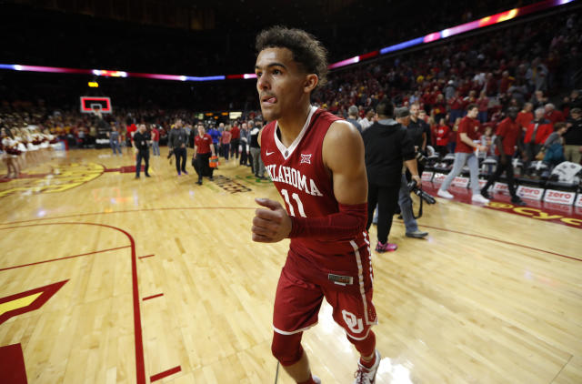 Oklahoma guard Trae Young runs off the court at the end of an NCAA college basketball game against Iowa State, Saturday, Feb. 10, 2018, in Ames, Iowa. Iowa State won 88-80. (AP Photo/Charlie Neibergall)