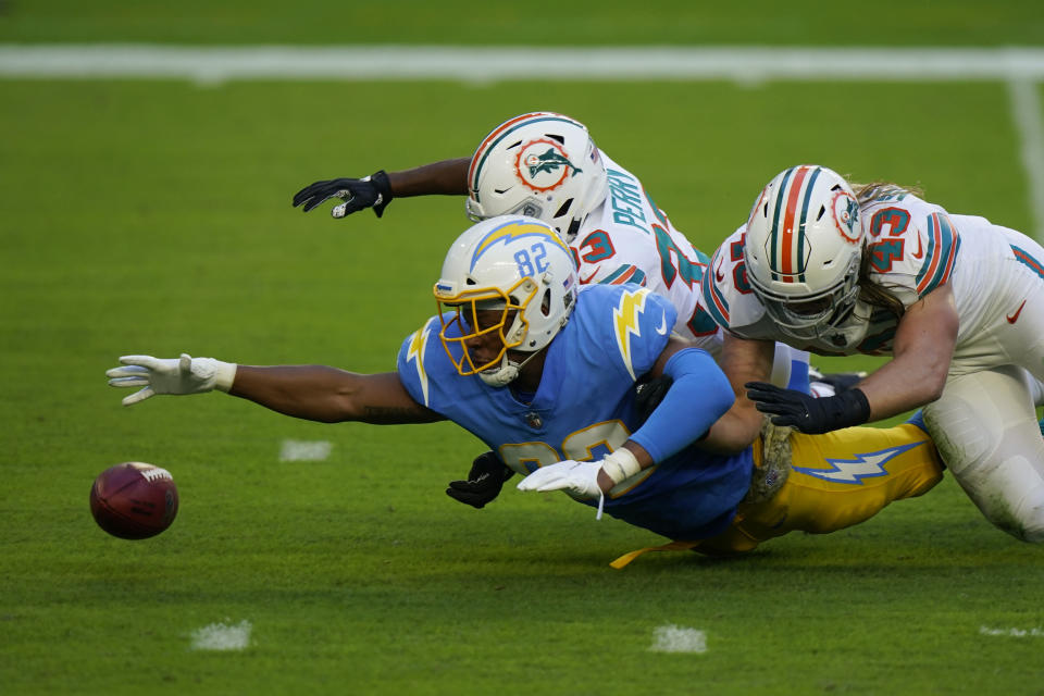 Los Angeles Chargers tight end Stephen Anderson (82), Miami Dolphins cornerback Jamal Perry (33) and outside linebacker Andrew Van Ginkel (43) go after the football after a punt was blocked, during the first half of an NFL football game, Sunday, Nov. 15, 2020, in Miami Gardens, Fla. (AP Photo/Wilfredo Lee)