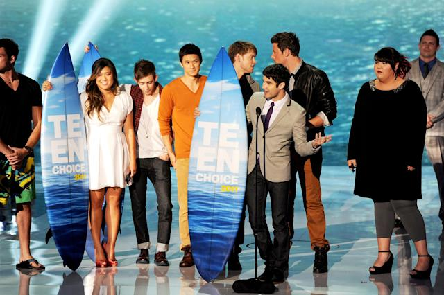 UNIVERSAL CITY, CA - AUGUST 07: (L-R) Actors Jenna Ushkowitz, Kevin McHale, Harry Shum Jr., Chord Overstreet, Cory Monteith, Darren Criss, Ashley Fink accept the Choice Comedy award onstage during the 2011 Teen Choice Awards held at the Gibson Amphitheatre on August 7, 2011 in Universal City, California. (Photo by Kevin Winter/Getty Images)