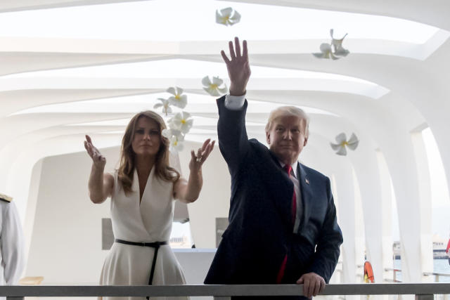 <p>President Donald Trump and first lady Melania Trump throw flower pedals while visiting the Pearl Harbor Memorial in Honolulu, Hawaii Friday, Nov. 3, 2017. Trump paid a solemn visit Friday to Pearl Harbor and its memorial to the USS Arizona, a hallowed place he said he had read about, discussed and studied but had never visited until just before opening his first official visit to Asia. (Photo: Andrew Harnik/AP) </p>