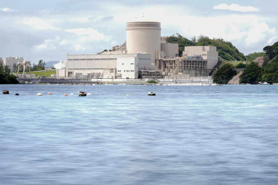 The No. 3 reactor of the Mihama Nuclear Power Plant operated by Kansai Electric Power Co. is seen in Mihama town, Fukui prefecture, central Japan, Wednesday, June 23, 2021. The more than 40-year-old nuclear reactor which suffered a deadly accident resumed operation Wednesday after being taken offline for a decade after the March 2011 Fukushima nuclear disaster, as Japan pushes to meet its carbon emissions reduction goal. (Kyodo News via AP)
