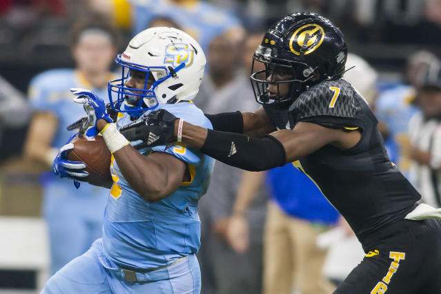 """Grambling State safety <a class=""""link rapid-noclick-resp"""" href=""""/ncaaf/players/273793/"""" data-ylk=""""slk:Danquarian Fields"""">Danquarian Fields</a>, right, nearly lost his right leg after a gruesome injury on Saturday in their game against Louisiana Tech. (Nick Tre Smith/Getty Images)"""