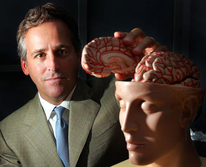 Richard Pops, CEO of Alkermes, Inc., shows a human brain model at his company in Cambridge, Mass., Wednesday, Aug. 3, 2005. Cambridge-based Alkermes Inc. expects to hear back from federal regulators by Sept. 30 on its application to begin marketing its new drug, Vivitrex, to doctors specializing in addiction medicine. (AP Photo/Chitose Suzuki)