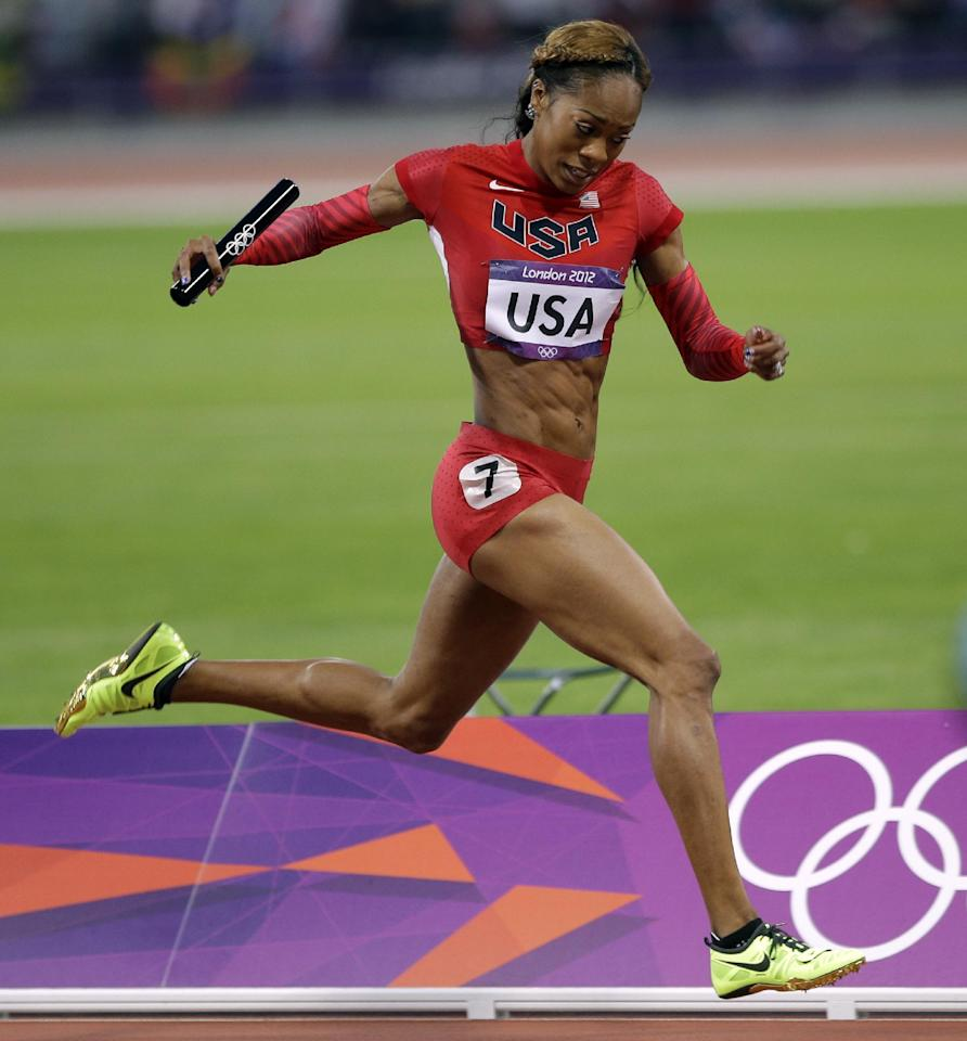 USA's Sanya Richards-Ross heads to the finish line to win the gold medal in the women's 4x400-meter during the athletics in the Olympic Stadium at the 2012 Summer Olympics, London, Saturday, Aug. 11, 2012. (AP Photo/Matt Slocum)
