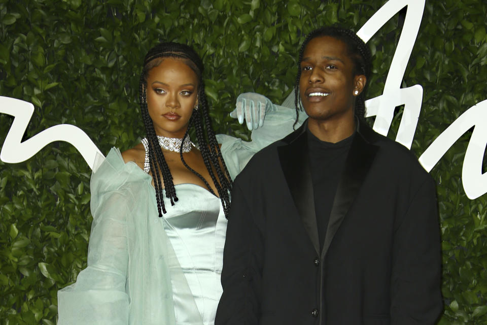 Singers Rihanna, left, and ASAP Rocky pose for photographers upon arrival at the British Fashion Awards in central London, Monday, Dec. 2, 2019.