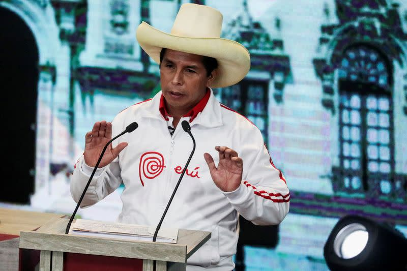FILE PHOTO: Peru's socialist candidate Pedro Castillo gestures during a debate in Arequipa
