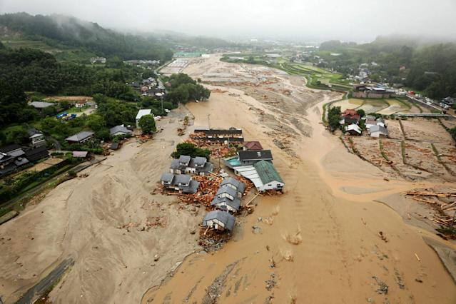 <p>An areal view of flooded Asakura City, Fukuoka prefecture, on July 6, 2017. (Photo: STR/AFP/Getty Images) </p>