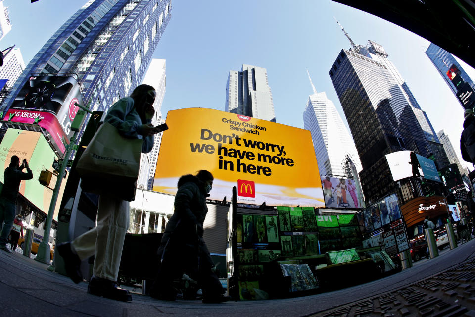 NEW YORK - NEW YORK - APRIL 13: People walk near McDonald's at Times Square on April 13, 2021 in New York. More than 300 corporates including Google and Mc Donalds are pushing the Biden administration to almost double the United States target for cutting the planet warming emissions, ahead global summit on climate change in 2021. (Photo by John Smith/VIEWpress)