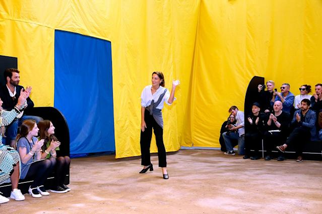 British fashion designer Phoebe Philo waves to the audience at the end of the Céline show during Paris Fashion Week during October 2015. (Photo: Bertrand Rindoff Petroff/Getty Images)