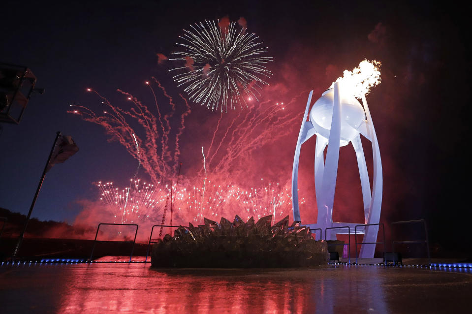 <p>Fireworks explode behind the Olympic flame during the opening ceremony of the 2018 Winter Olympics in Pyeongchang, South Korea, Friday, Feb. 9, 2018. (AP Photo/David J. Phillip,Pool) </p>