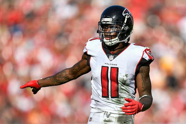 """<a class=""""link rapid-noclick-resp"""" href=""""/nfl/teams/atlanta/"""" data-ylk=""""slk:Falcons"""">Falcons</a> wide receiver Julio Jones is skipping OTAs for the second straight year. (Photo by Roy K. Miller/Icon Sportswire via Getty Images)"""