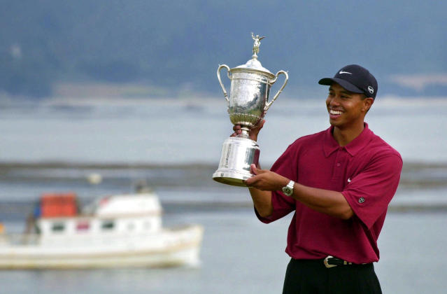 FILE - In this June 18, 2000, file photo Tiger Woods holds the trophy after capturing the 100th U.S. Open Golf Championship at the Pebble Beach Golf Links in Pebble Beach, Calif. For all his feats, however, nothing compares with Woods' 15-shot victory in the 2000 U.S. Open at Pebble Beach, the largest margin in major championship history. (AP Photo/Elise Amendola, File)
