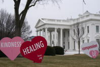 A Valentine's Day decoration, signed by first lady Jill Biden, sits on the North Lawn of the White House, Friday, Feb. 12, 2021, in Washington. (AP Photo/Evan Vucci)