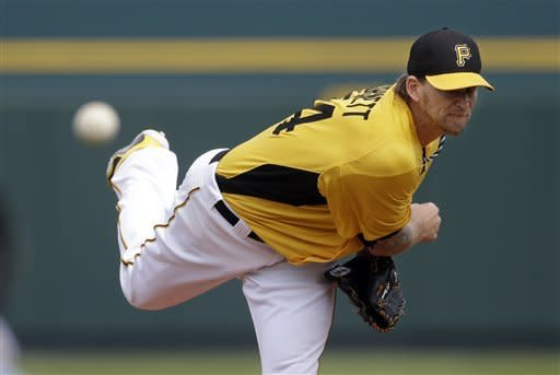 Pittsburgh Pirates starting pitcher A.J. Burnett throws during the first inning of an exhibition spring training baseball game against the Minnesota Twins, Saturday, March 9, in Bradenton, Fla. (AP Photo/Carlos Osorio)