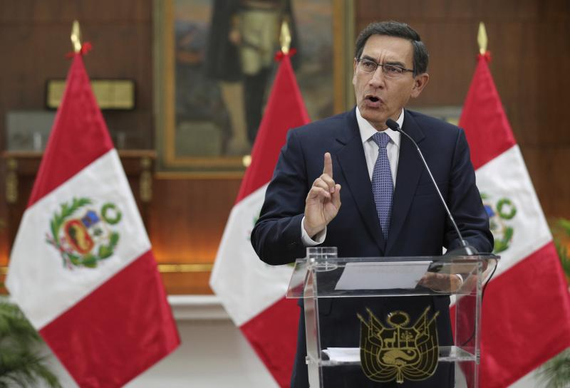 Peru's President Martin Vizcarra delivers a national message at Government Palace, after an emergency cabinet meeting in Lima, Peru, Friday, Sept. 27, 2019. Congress on Thursday shelved Vizcarra's proposal to call early elections so that he may step down. (AP Photo/Martin Mejia)