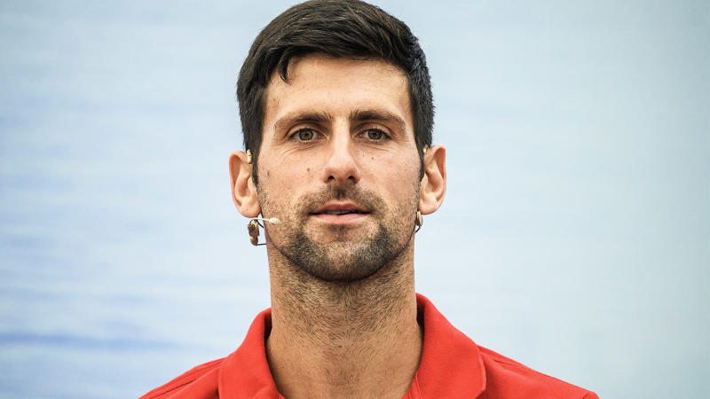 Novak Djokovic (pictured) answering questions on stage.