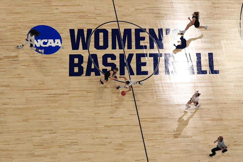 The court at the Alamodome in San Antonio includes generic branding for the women's tournament.