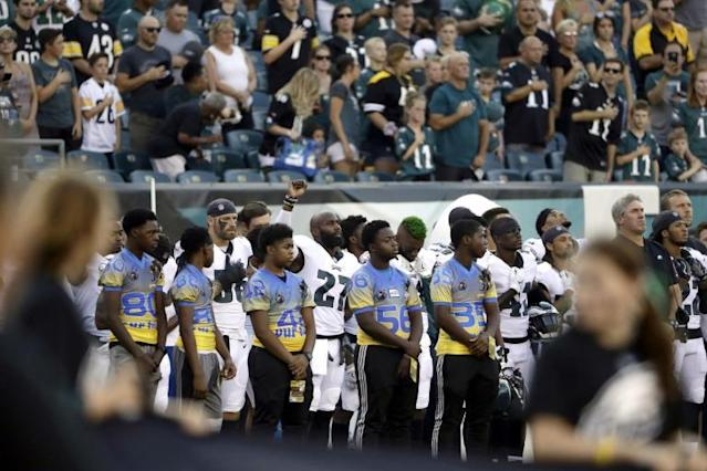 Trump attacks NFL players after 'anthem protests' at opening games of season
