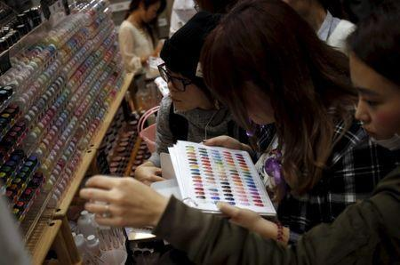 Shoppers look at various colors of manicure displayed at an exhibition and sale during Tokyo Nail Expo 2015 in Tokyo, Japan, November 15, 2015. REUTERS/Yuya Shino