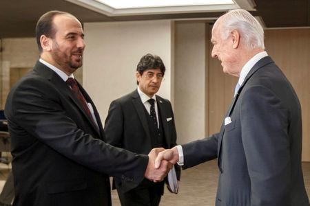 UN Special Envoy of the Secretary-General for Syria Staffan de Mistura shakes hands with Syria's main opposition HNC leader Nasr al-Hariri prior to a round of negotiations at the European headquarters of the United Nations in Geneva