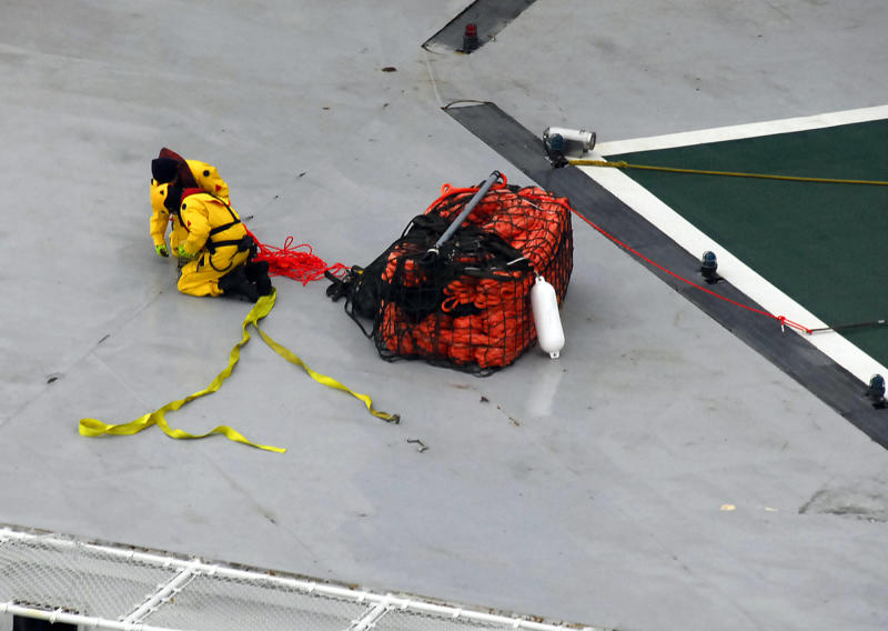 A photo provided by the U.S. Coast Guard shows a salvage team wrapping up lines from an emergency towing system delivered to the deck of the petroleum drilling ship Kulluk Wednesday, Jan. 2, 2013, in the Gulf of Alaska. The grounding of the drill ship on a remote Alaska island has refueled the debate over oil exploration in the U.S. Arctic Ocean. (AP Photo/U.S. Coast Guard)